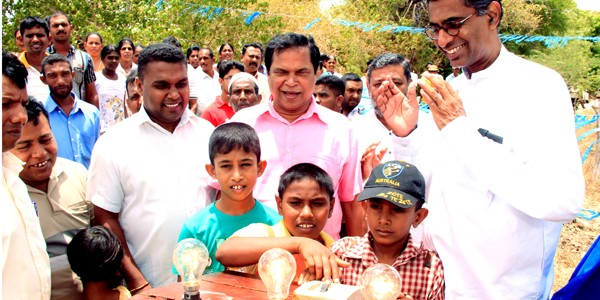 1035 families in Killinochchi and Anuradhapura receive electricity connections.