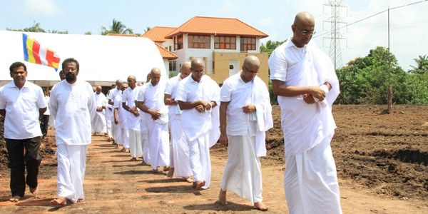 Minister Patali Champika Ranawaka together with 22 others shave their heads and observe Dasa Sil.